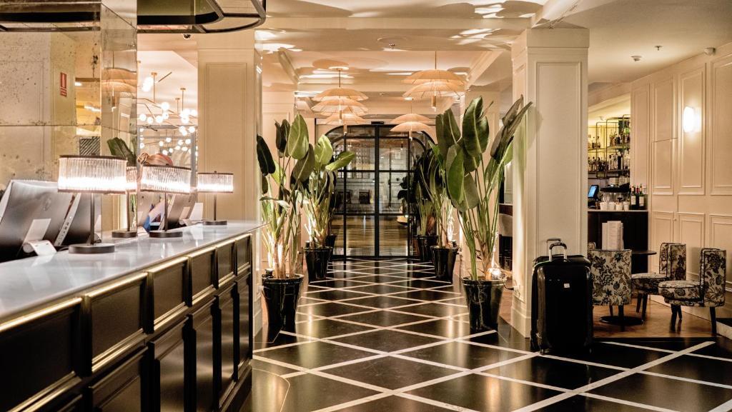 Een restaurant of ander eetgelegenheid bij Hotel Regina