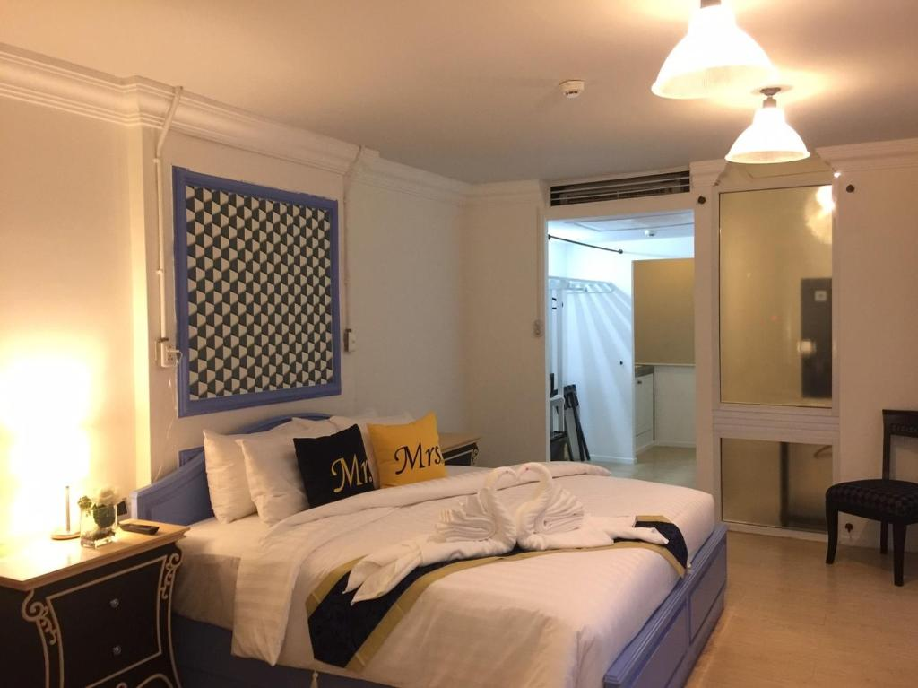 Кровать или кровати в номере Dreamers Paradise Hotel & Resort