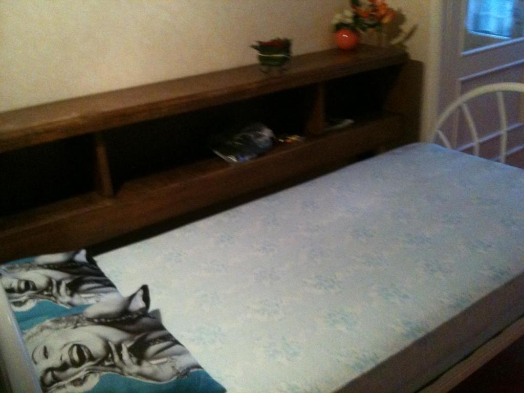 Un ou plusieurs lits dans un hébergement de l'établissement Chambres Levadoux