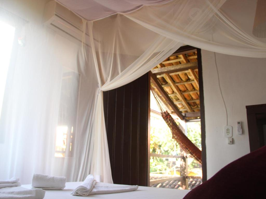 A bed or beds in a room at Pousada Raiz Forte