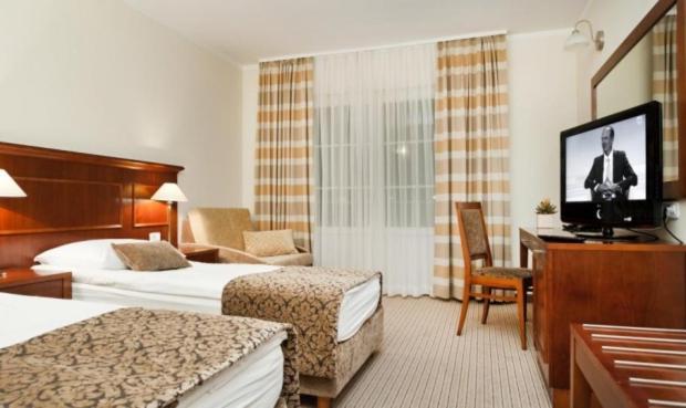 Gulta vai gultas numurā naktsmītnē Hotel Cateski Dvorec