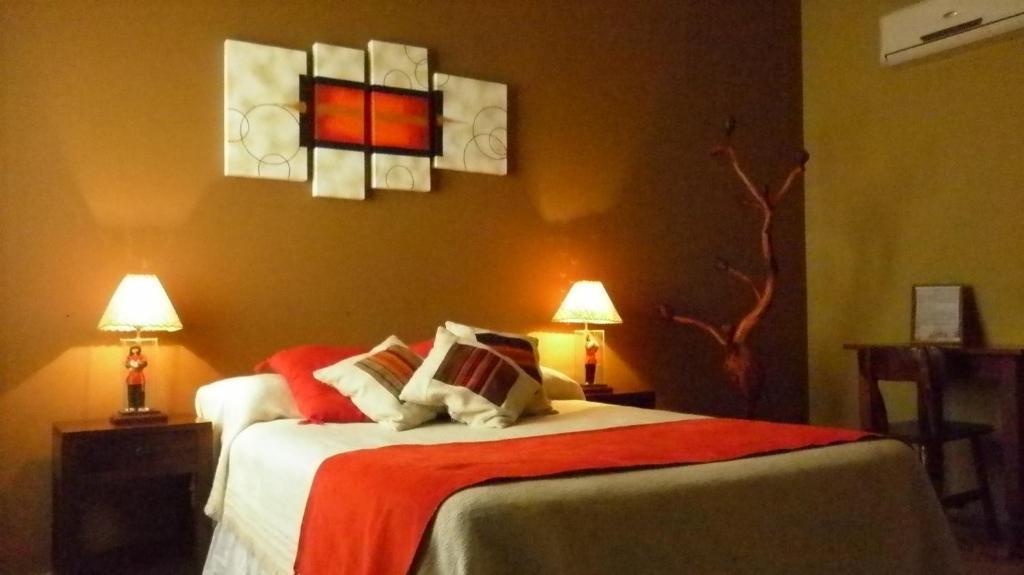 A bed or beds in a room at Cerro de la Cruz
