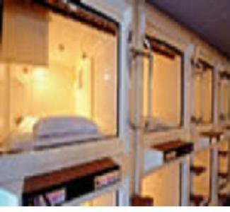 A bunk bed or bunk beds in a room at Capsule Hotel Kobe Sannomiya (Male Only)
