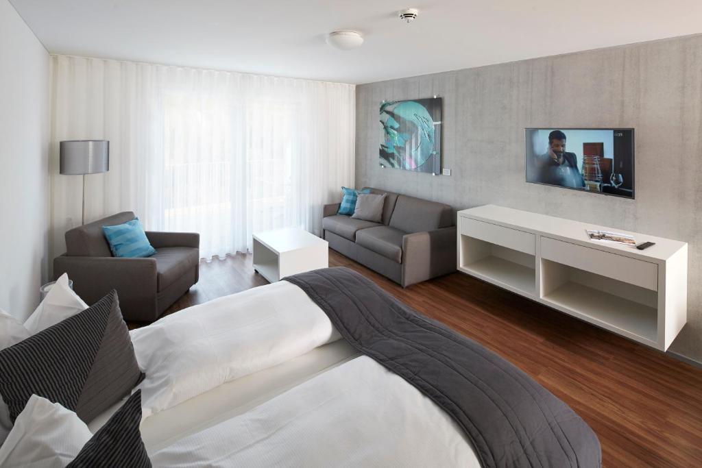 Ein Sitzbereich in der Unterkunft Aparthotel Baden