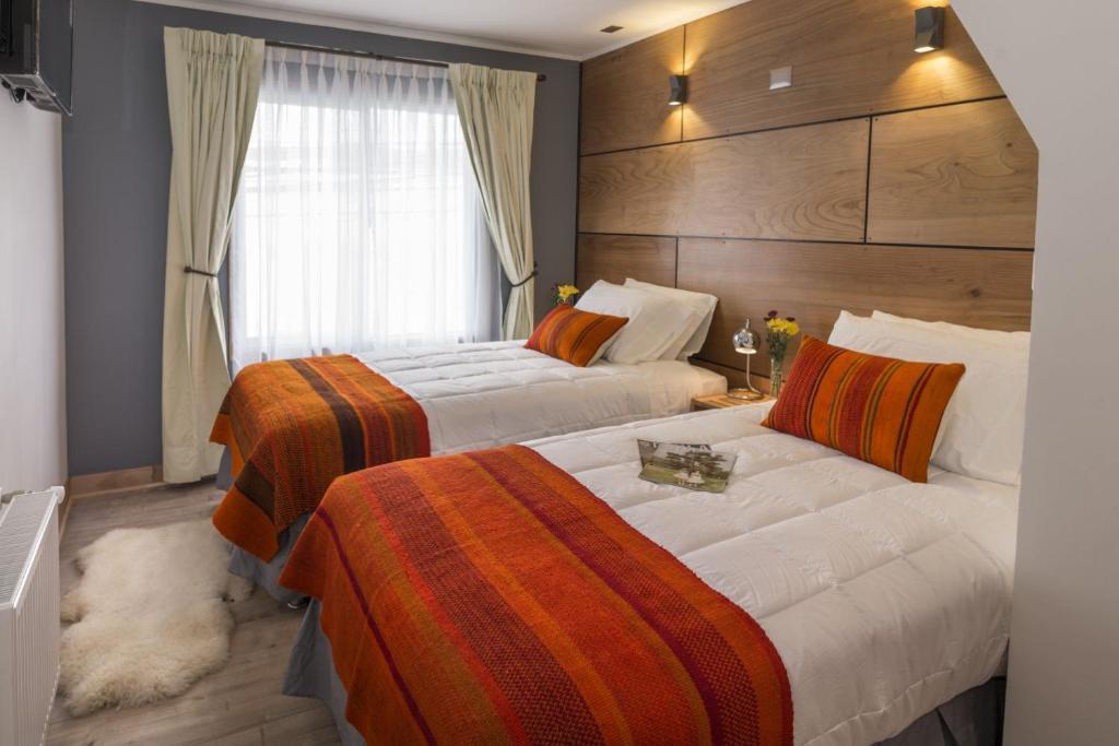 Cama o camas de una habitación en Hotel Angelmontt