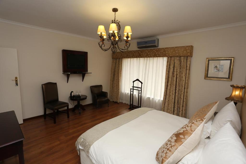 Ein Bett oder Betten in einem Zimmer der Unterkunft Villa Moringa Guesthouse