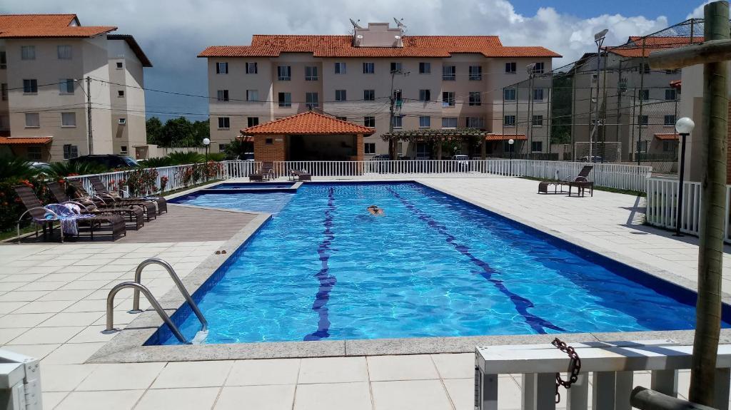 The swimming pool at or near Sossego em Ilhéus