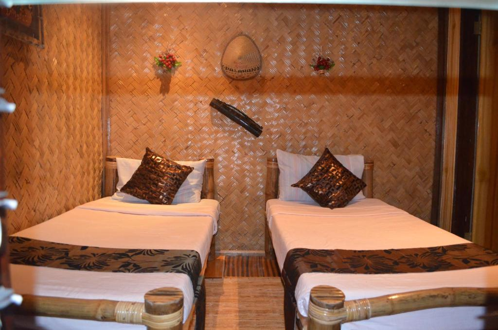 A bed or beds in a room at Balay Paragua