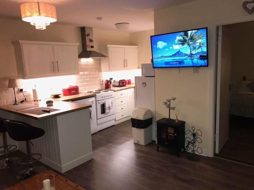 A kitchen or kitchenette at Trinity Apartments