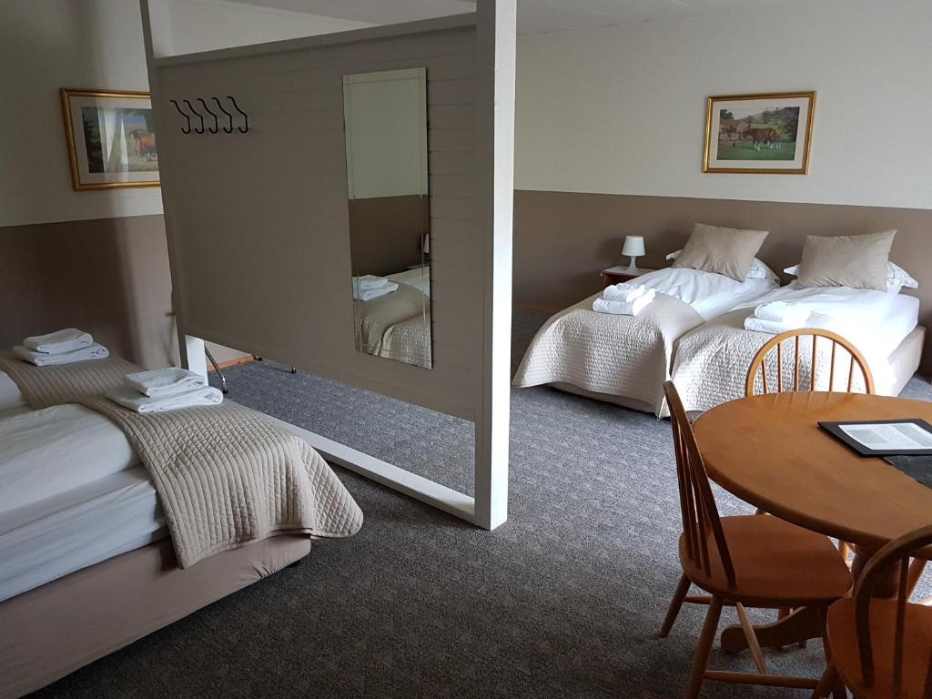 A bed or beds in a room at Lamb Inn Öngulsstadir