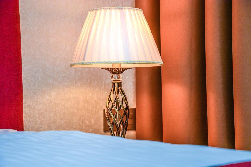 Кровать или кровати в номере Отель Раймонд