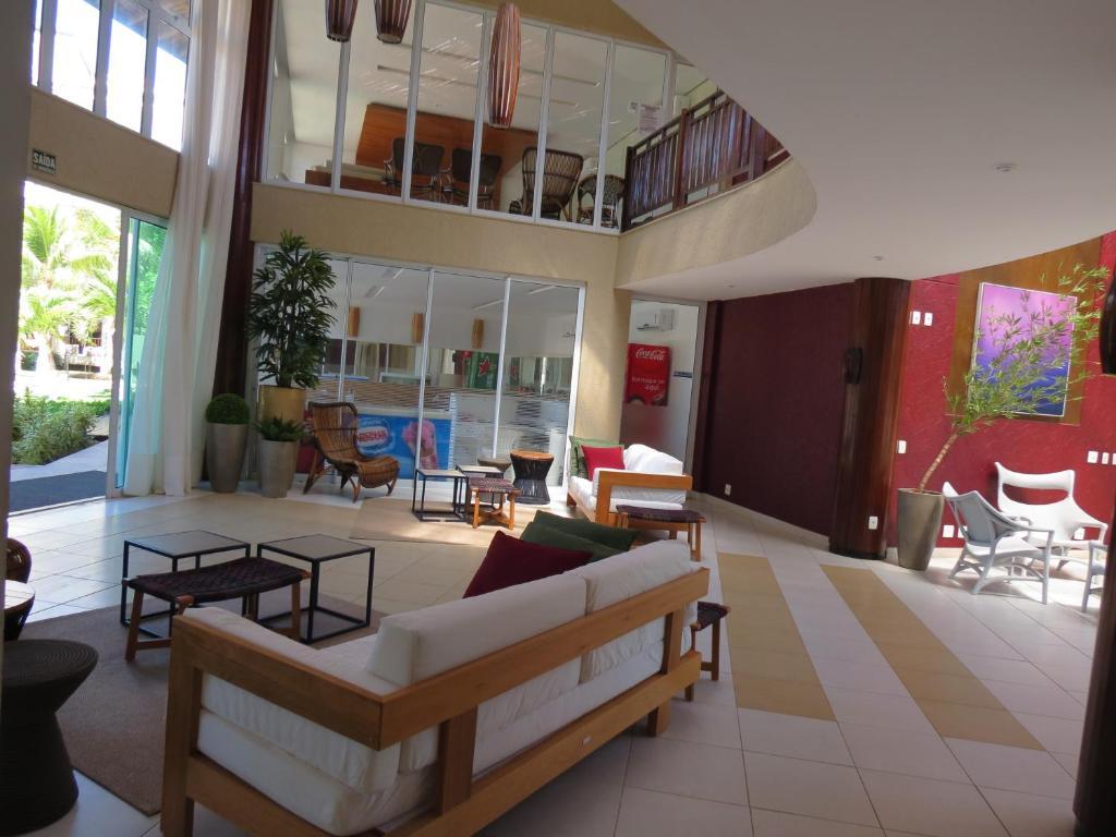 The lobby or reception area at Conforto e Lazer no Porto das Dunas