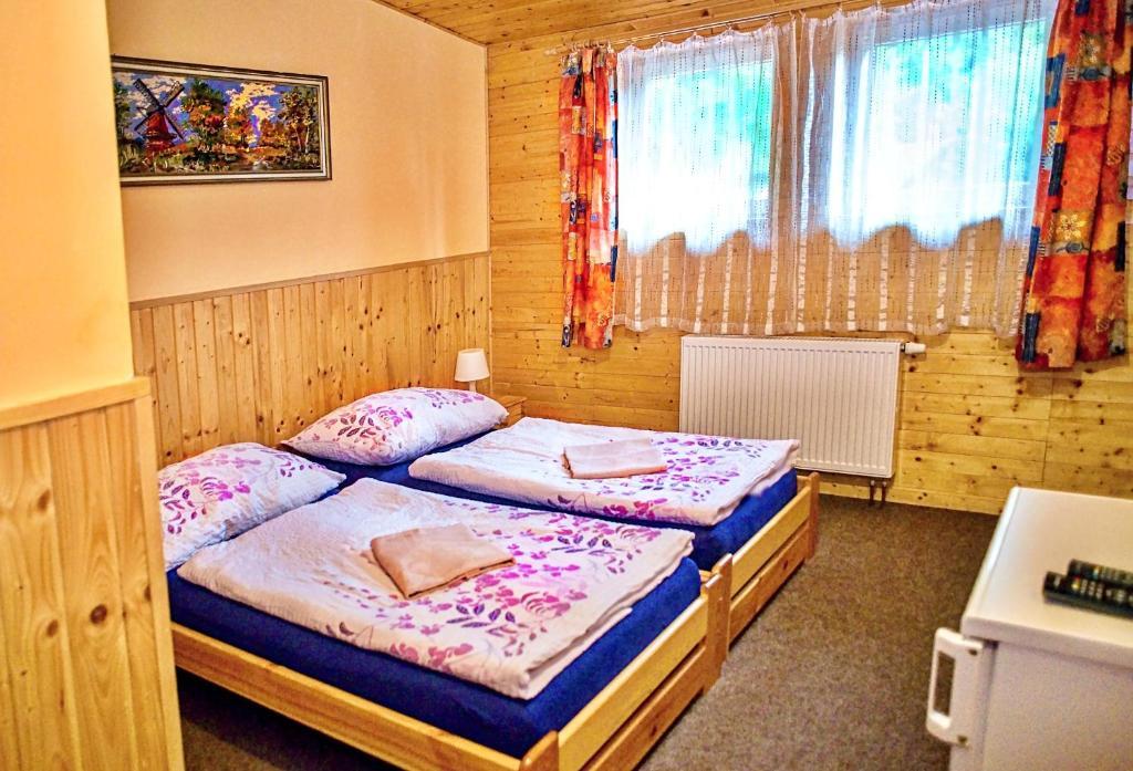Una cama o camas en una habitación de Privat Radošov