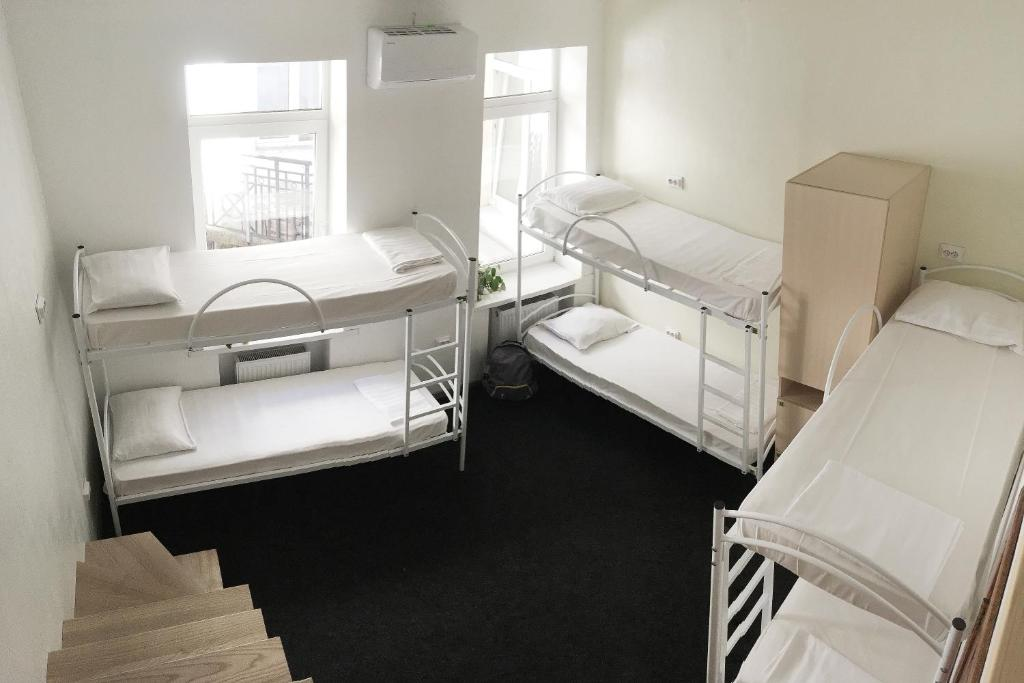 A bunk bed or bunk beds in a room at Hostel N1