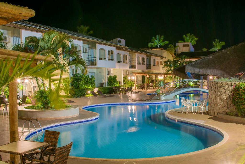 The swimming pool at or near Sarana Praia Hotel