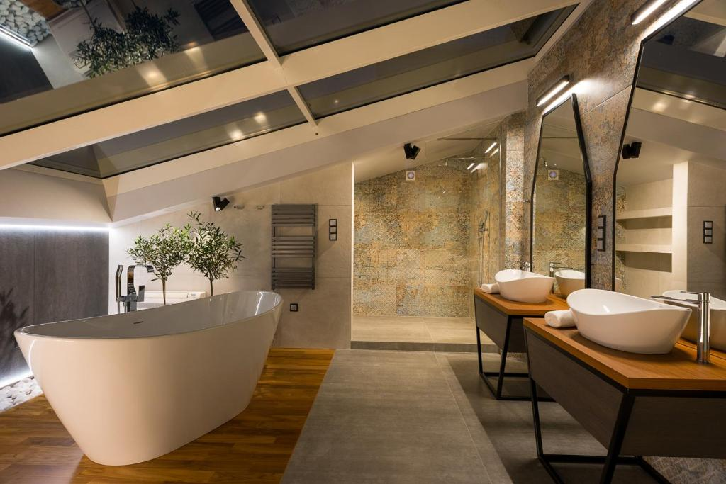 Salle de bains dans l'établissement Privilege Suites