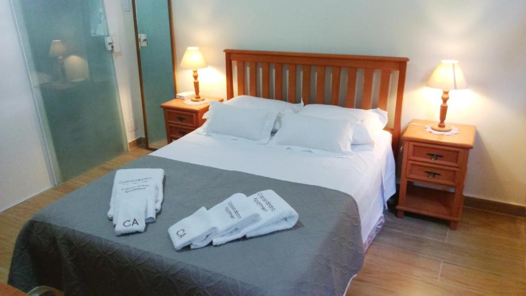 Postel nebo postele na pokoji v ubytování Copacabana Apartment