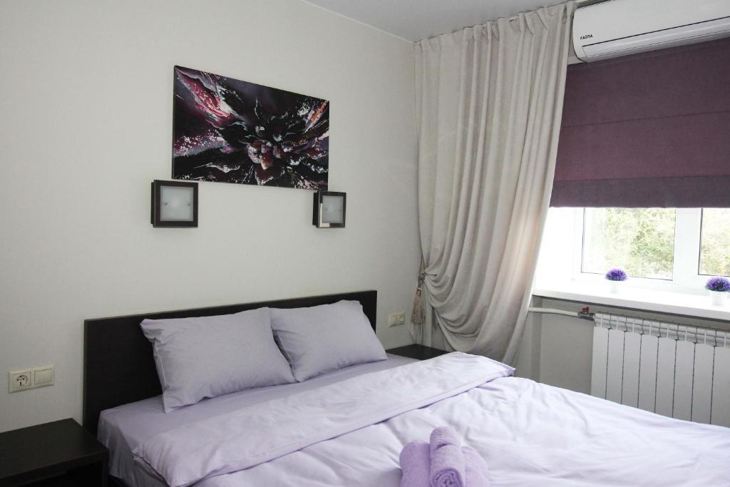 מיטה או מיטות בחדר ב-City Hostel