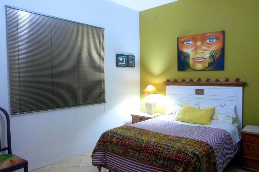 Cama ou camas em um quarto em Suíte B&B Sul da Ilha