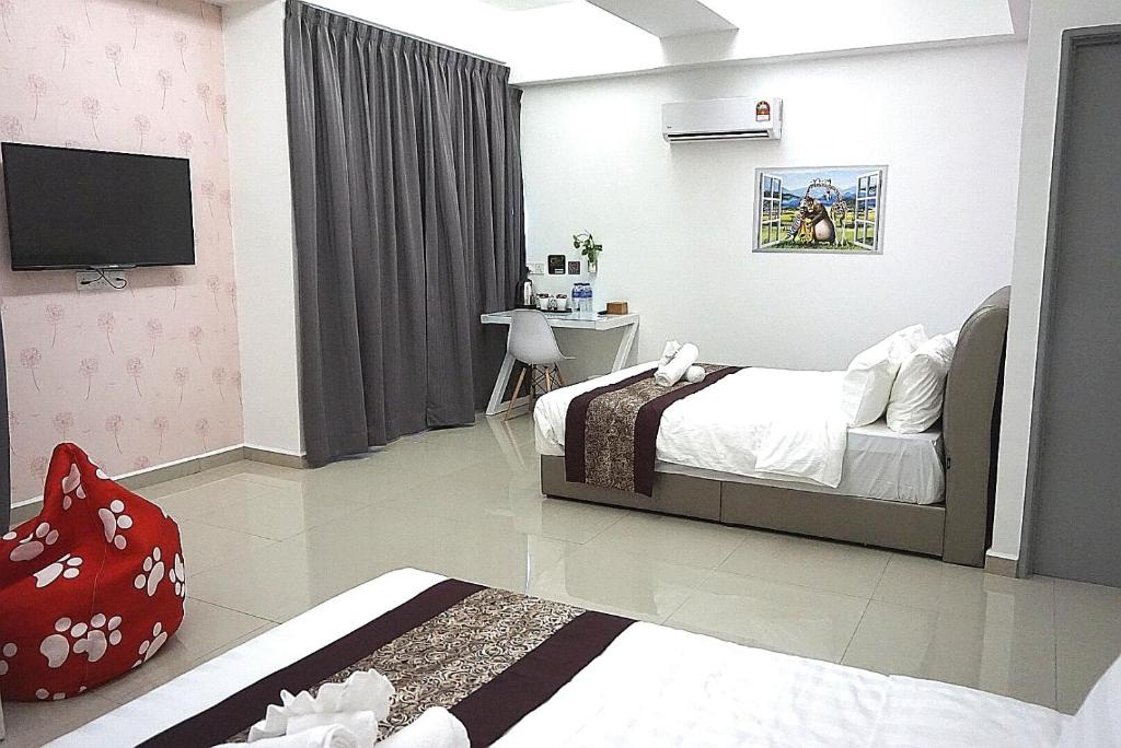 A bed or beds in a room at D' Cozy Inn