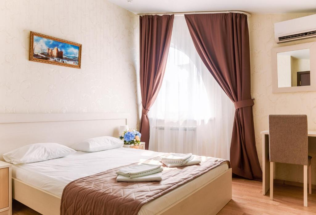 A bed or beds in a room at Isaevsky