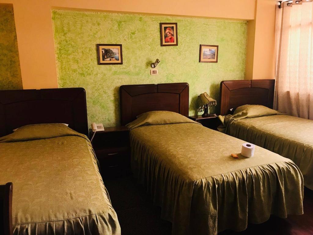 Cama o camas de una habitación en Hotel Savoy
