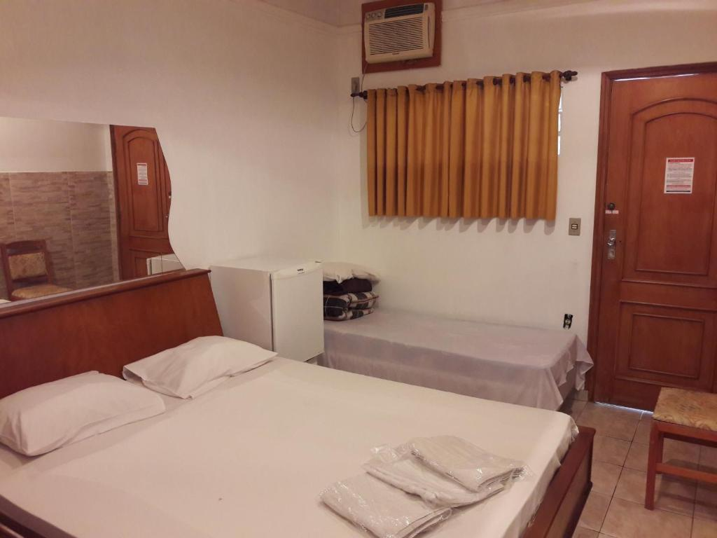A bed or beds in a room at Pousada Hotel D. Pedro Express