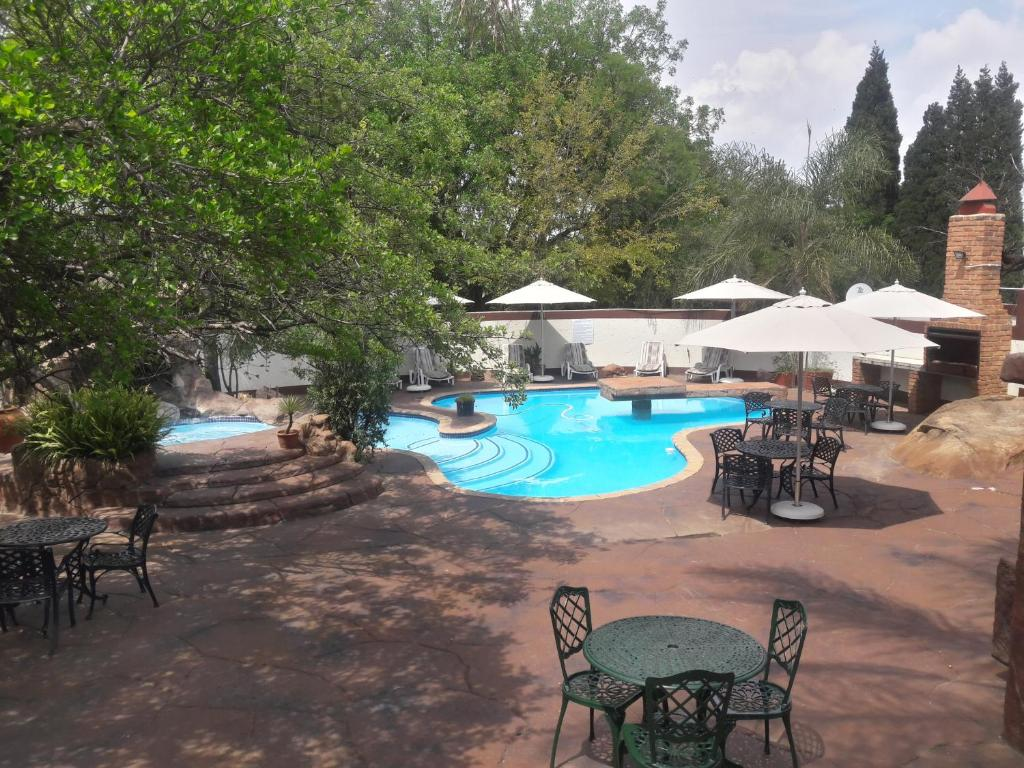 A view of the pool at Ecotel Midrand or nearby