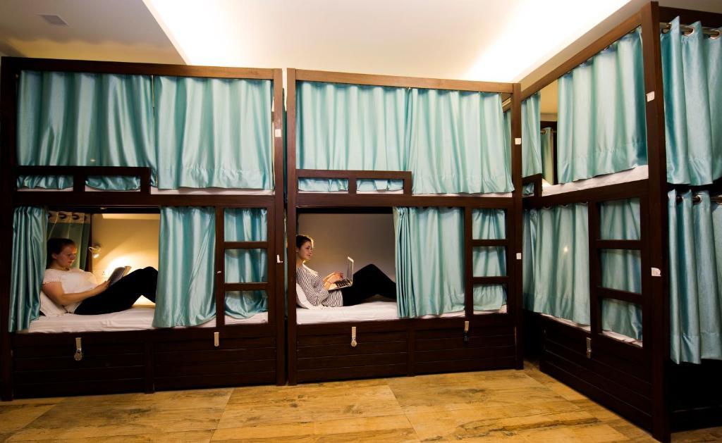 Ein Etagenbett oder Etagenbetten in einem Zimmer der Unterkunft Joey's Hostel