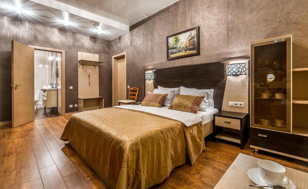 Кровать или кровати в номере Гостиница Браво Люкс