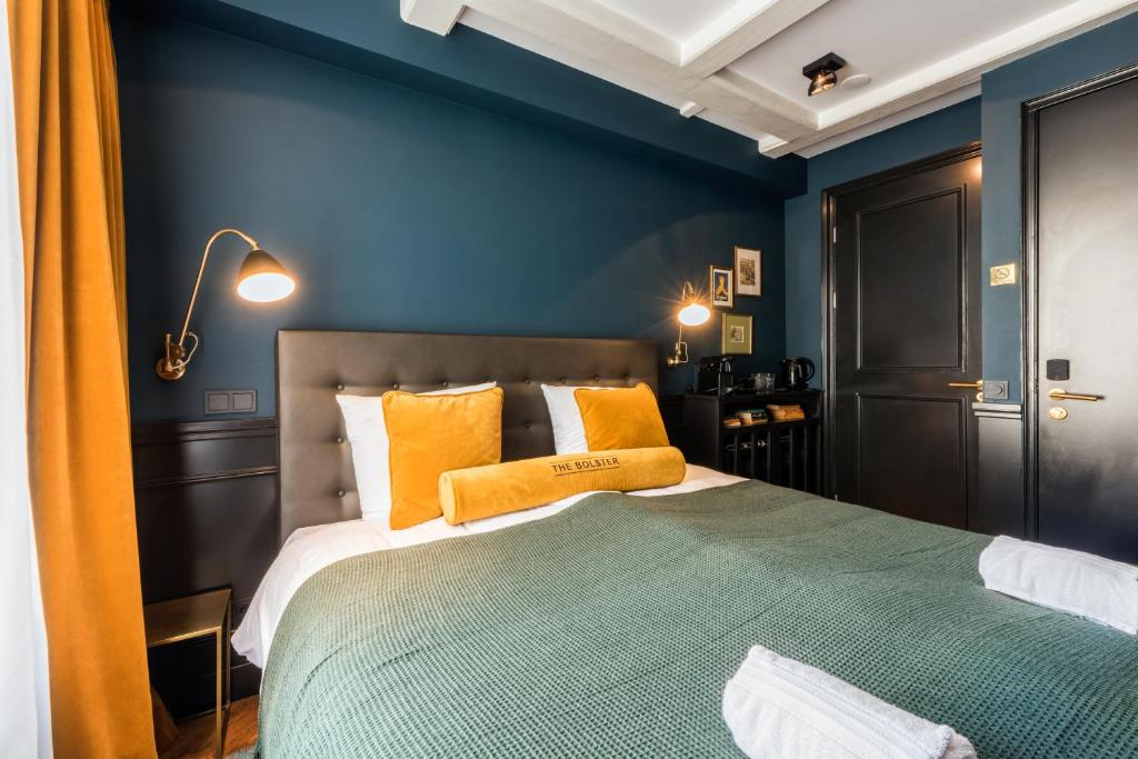 A bed or beds in a room at The Bolster