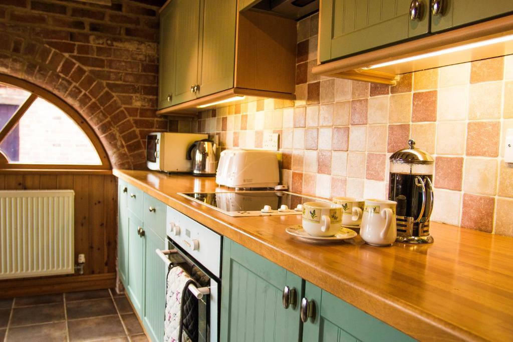 A kitchen or kitchenette at Lodge Barns