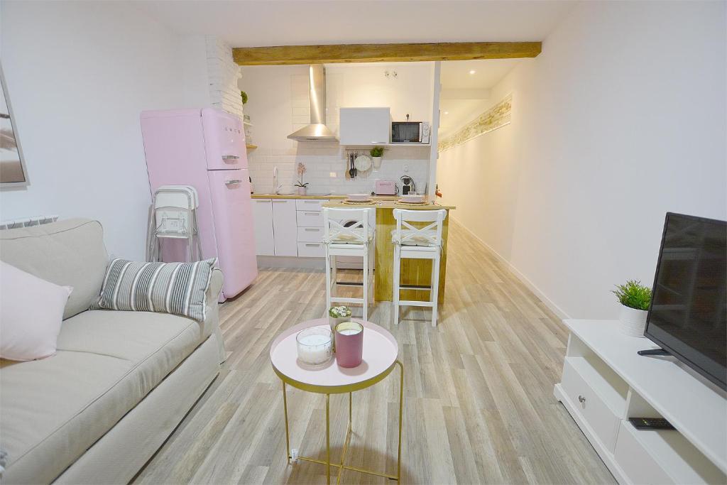 A seating area at Alisol Apartamento