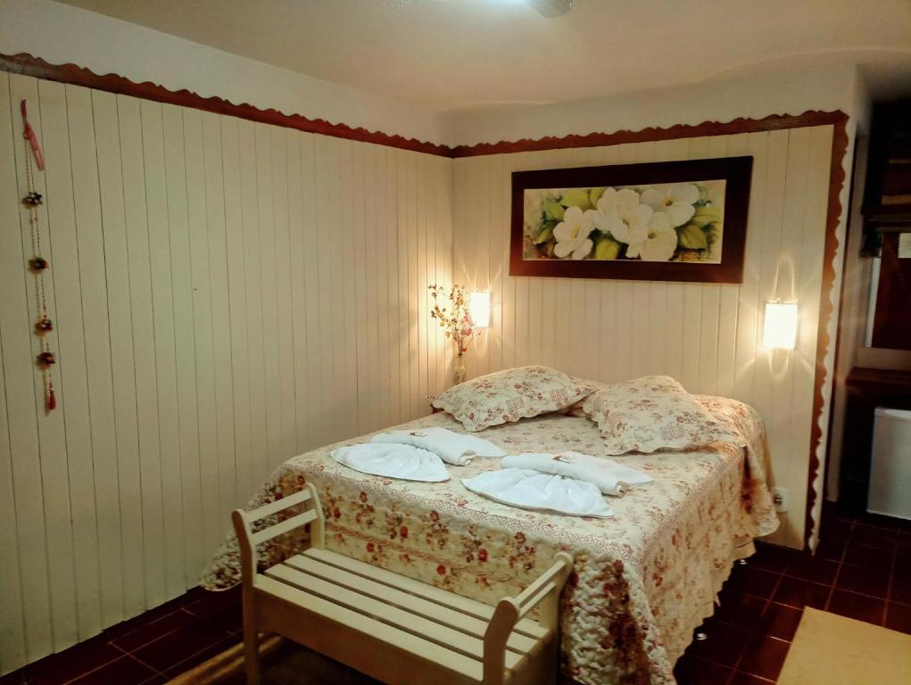 Säng eller sängar i ett rum på Recanto dos Ypês Monte Verde