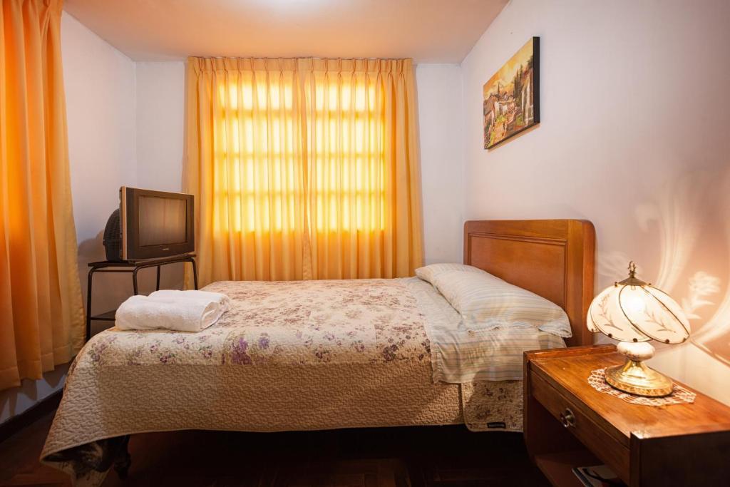 Cama o camas de una habitación en Hospedaje Ochoa Jara