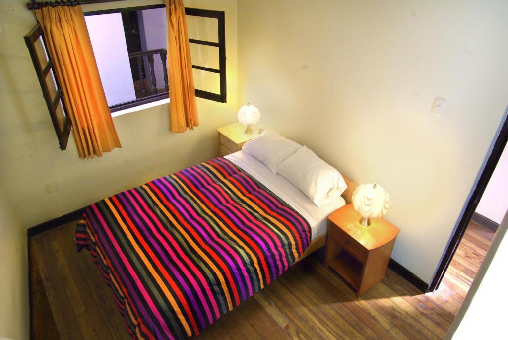 Cama ou camas em um quarto em Mama Simona - Cusco