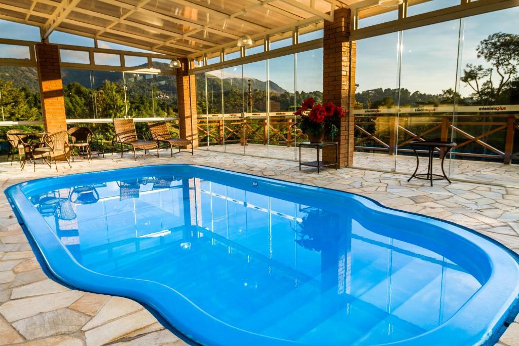 A piscina localizada em Pousada Suíça Mineira ou nos arredores