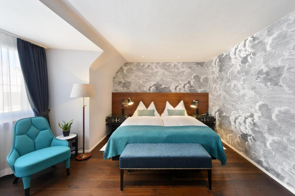 A bed or beds in a room at Hotel City Zürich Design & Lifestyle