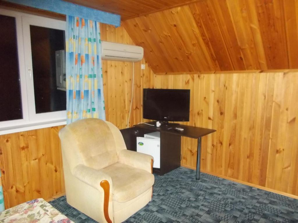 A television and/or entertainment center at Guest House Aton