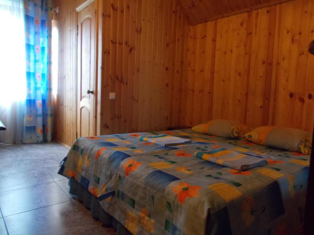 A bed or beds in a room at Guest House Aton