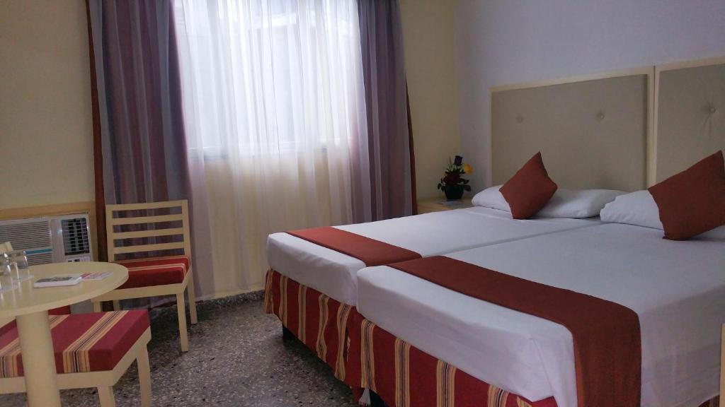 Cama o camas de una habitación en Hotel Deauville