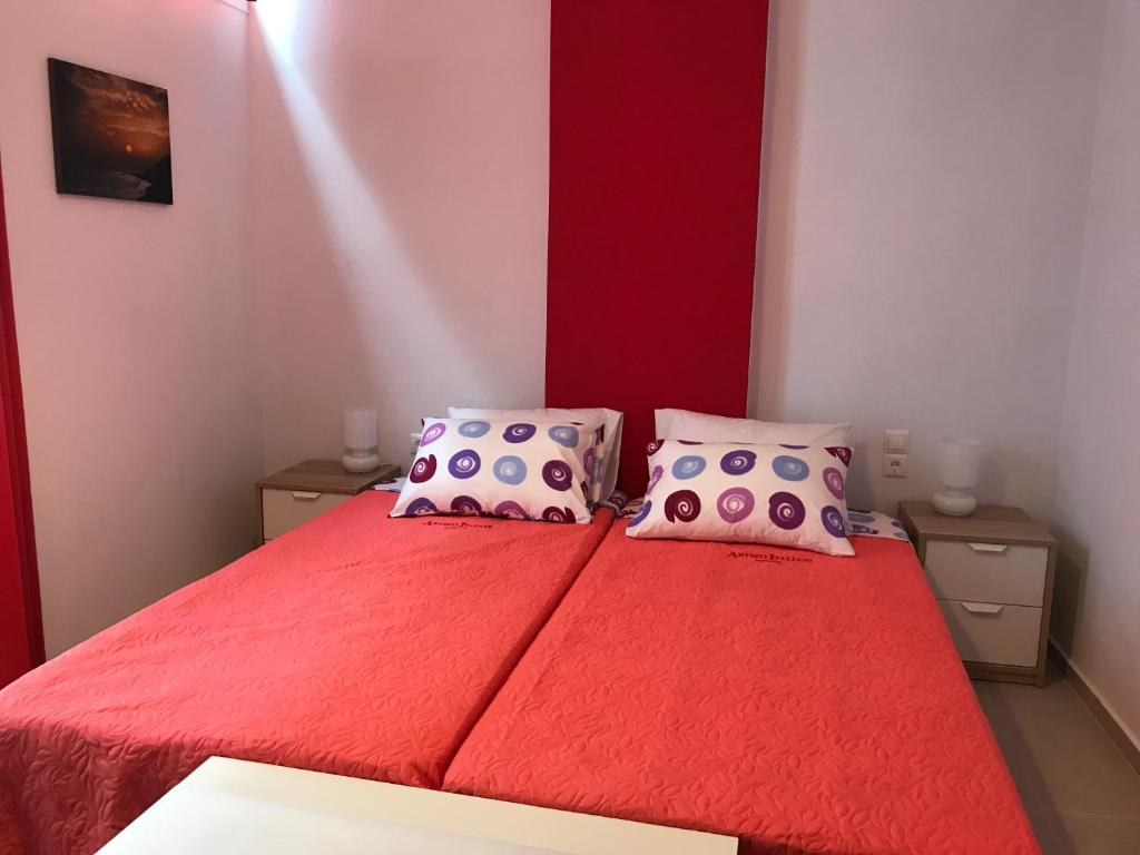 A bed or beds in a room at Mirtos Apartments