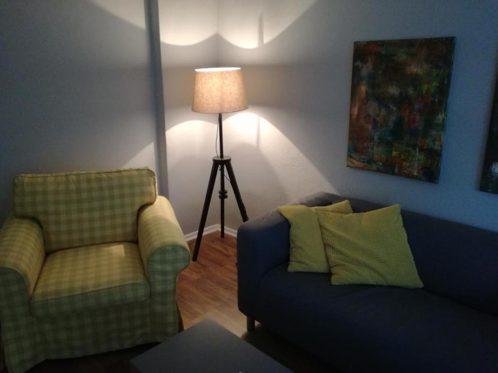 A seating area at Gruga Apartment an der Messe