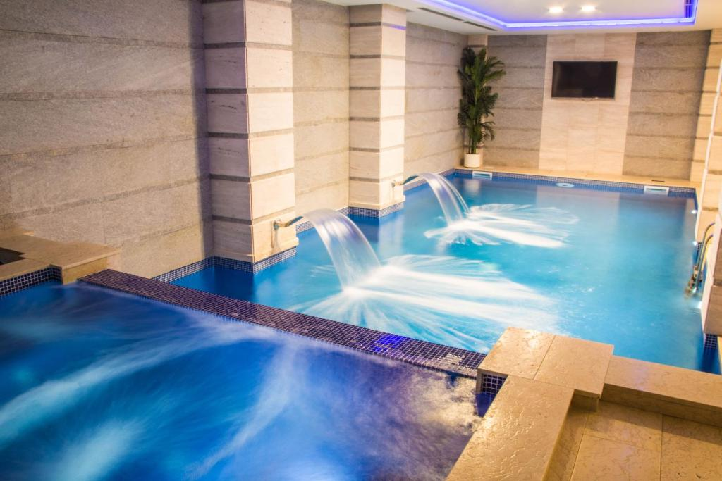 The swimming pool at or near Xenon Hotel