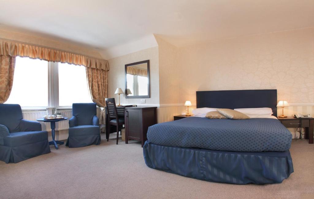 מיטה או מיטות בחדר ב-Langorf Hotel