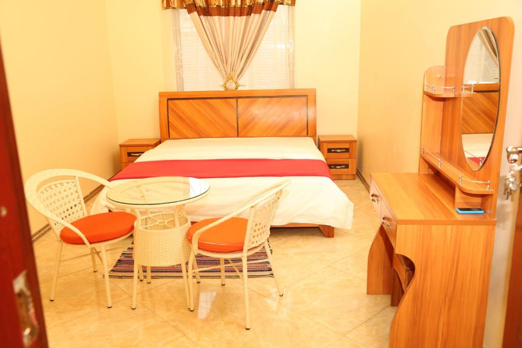 A bed or beds in a room at Dalma Lodge
