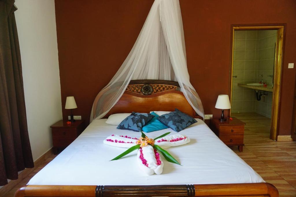 Un ou plusieurs lits dans un hébergement de l'établissement Chalet Bamboo Vert