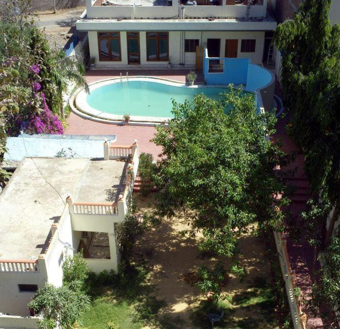A view of the pool at Pushkar Villas Resort or nearby