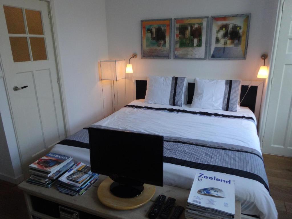 Een bed of bedden in een kamer bij B&B Vierwinden