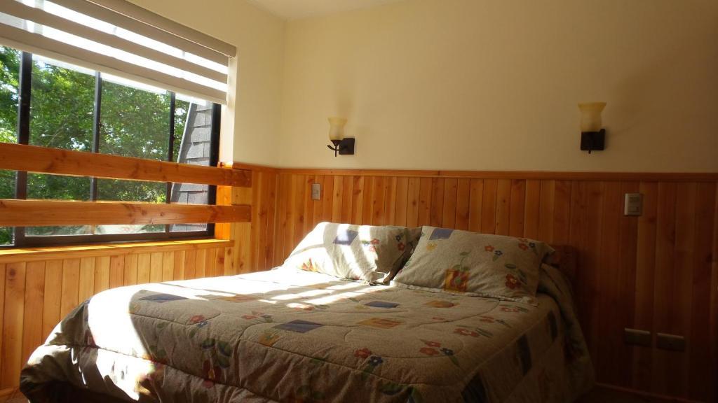 Cama o camas de una habitación en Peumayén Departamento Pucón